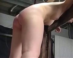 Girl in stockade. spanking