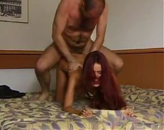 Redhead beauty getting fucked by older man