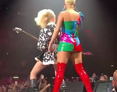 Katy Perry performing in red boots with short blonde hair